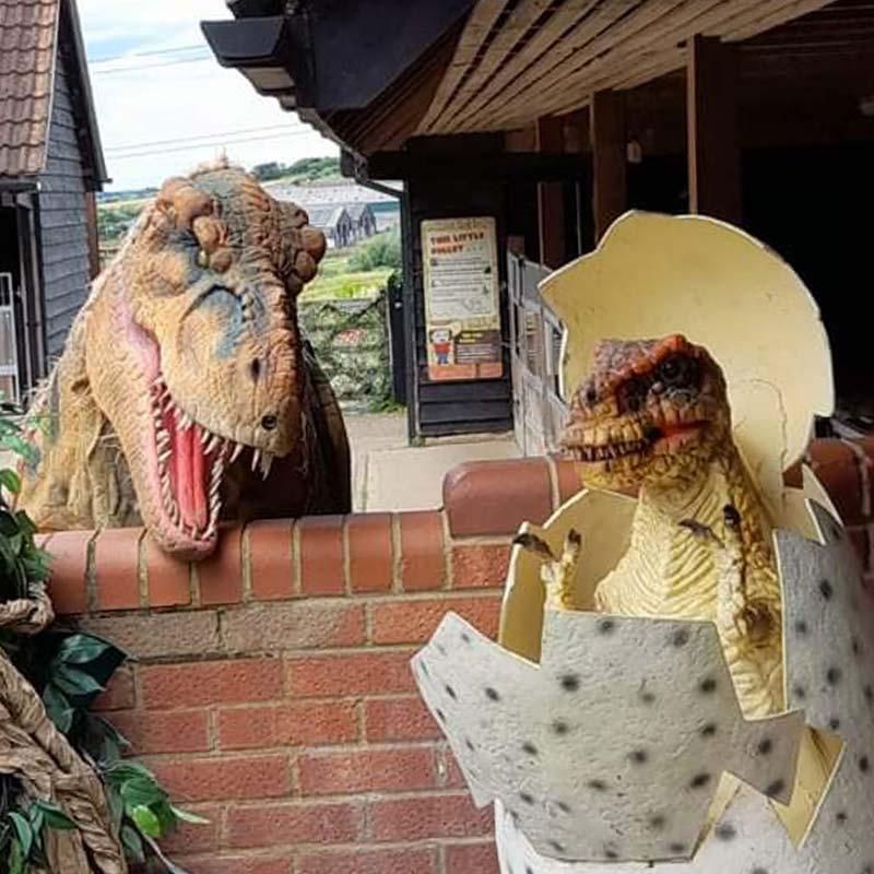 Dinosaur protecting her dinosaur egg